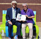 Joe Longthorne with Jane Eyre from the Education Centre with a copy of Joe's autobiography.