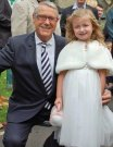 Joe Longthorne with Tracey Jordan's daughter Carley at her christening a few weeks ago in October 2013, Joe became Carley's God parent at the ceremony in Blackpool, thanks to Tracey Jordan for the photo.