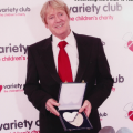 Joe Longthorne receiving the ' Silver Heart' Award from Variety Club The Children's Charity' in 2010.